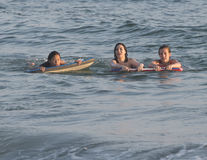 Girls floating on body boards in the Ocean Royalty Free Stock Image