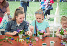 Girls at floristic workshop. Zaporizhia/Ukraine- May 28, 2017: Charity Family festival:  teen girls participating at floristic workshop, learning to arrange Royalty Free Stock Photos