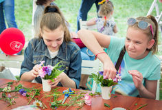 Girls at floristic workshop. Zaporizhia/Ukraine- May 28, 2017: Charity Family festival:  teen girls participating at floristic workshop, learning to arrange Stock Image