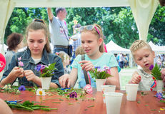 Girls at floristic workshop. Zaporizhia/Ukraine- May 28, 2017: Charity Family festival:  teen girls participating at floristic workshop, learning to arrange Stock Photos