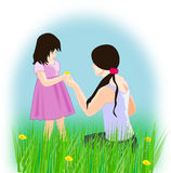 Girls in a Flower Meadow Stock Photography