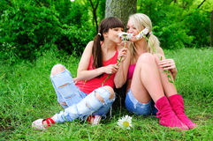 Girls with flowers stock photos
