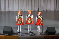 Girls in folk costume performs on stage Royalty Free Stock Images
