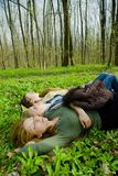 Girls in the forest. Girlfriends lying on their back and resting, sleeping in the forest Stock Photography