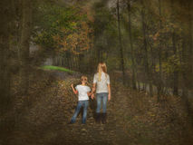 Girls on forest footpath Royalty Free Stock Photos