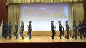 Girls in the form of marching on stage ,with arms in their hands. Vologda.Russia. December 2015.Girls in the form of marching on stage ,with arms in their hands stock footage