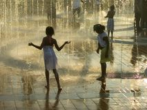 Girls in fountain. Atlanta Centennial Olympic Parc, Georgia, USA royalty free stock photo
