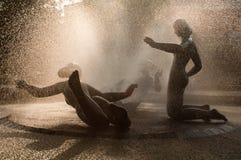 Girls fountain Stock Photography