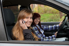 Girls friends in car Royalty Free Stock Photos