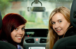 Girls friends in car Stock Image