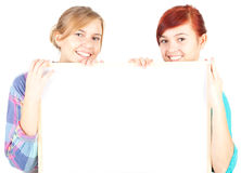 Girls friends holding blank billboard Royalty Free Stock Images