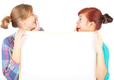 Girls friends holding blank poster Stock Image