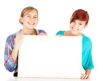 Girls friends holding blank poster Royalty Free Stock Photo