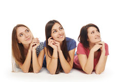 Girls friends lying smiling on floor Stock Photos
