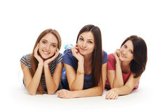 Girls friends lying smiling on floor Royalty Free Stock Image