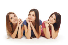 Girls friends lying smiling on floor Stock Photo
