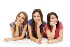 Girls friends lying smiling on floor Royalty Free Stock Photography