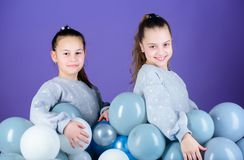Girls friends near air balloons. Start party. Birthday party. International childrens day. Carefree childhood. Sisters. Organize home party. Greeting concept royalty free stock image