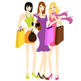 Girls' friends with shopping bags Stock Image