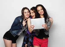 Girls friends taking selfie with digital tablet Stock Images