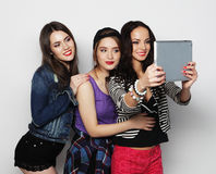 Girls friends taking selfie with digital tablet Stock Photo