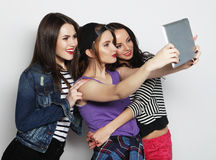 Girls friends taking selfie with digital tablet Royalty Free Stock Photography