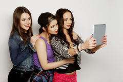 Girls friends taking selfie with digital tablet Stock Photos