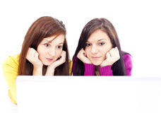 Girls in front of laptop Stock Photography