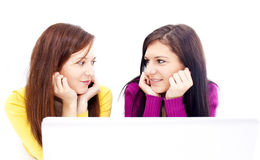 Girls in front of laptop Royalty Free Stock Images
