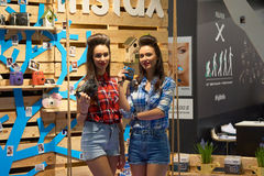 Girls at Fuji stand Stock Photography