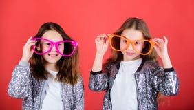 Girls funny big eyeglasses cheerful smile. Birthday party. Happy childhood. Sincere cheerful kids share happiness and. Love. Joyful and cheerful. Sisterhood royalty free stock photo