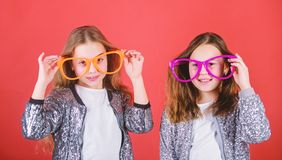 Girls funny big eyeglasses cheerful smile. Birthday party. Happy childhood. Sincere cheerful kids share happiness and. Love. Joyful and cheerful. Sisterhood stock images
