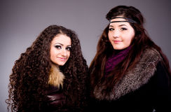Girls in a fur coat Stock Images