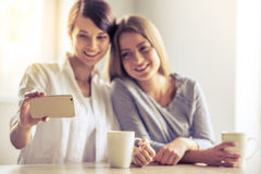 Girls with gadget Royalty Free Stock Photo
