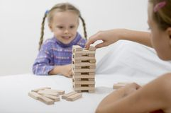 Girls / game / white. Girls playing. Focus on the fingers / blocks Stock Photography