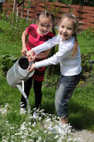 Girls in the garden royalty free stock photography
