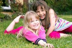 Girls in garden Stock Image