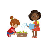 Girls Gardening Together Royalty Free Stock Photo