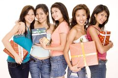 Girls and Gifts #1. Five pretty asian women holding gifts and presents Royalty Free Stock Image