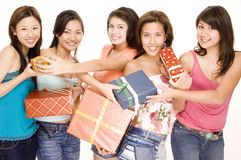 Girls and Gifts #2. Five pretty asian women swap gifts and presents Royalty Free Stock Photography
