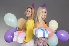 Girls with gifts and balloons at a birthday party Stock Photo