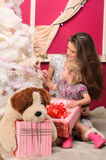 Girls with gifts at christmas tree indoors Stock Photos