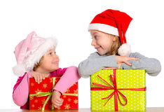 Girls girl with Santa- cap and presents Royalty Free Stock Images