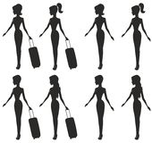 Girls. Girl with a suitcase and without a suitcase Royalty Free Stock Photography