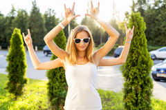 Girls girlfriend, summer day having fun, depict the concept of yoga, Shiva fashion style glasses smiling Stock Image
