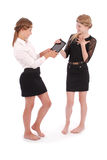 Girls give each other tablet PCs Royalty Free Stock Photos