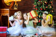 Girls give presents stock images