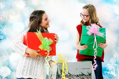 Girls giving presents at christmas. Royalty Free Stock Photos