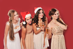 Girls with a glass of champagne meet new year Stock Photos