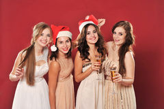 Girls with a glass of champagne meet new year Stock Photography